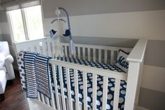 gray and white stripes, white furniture, navy accent