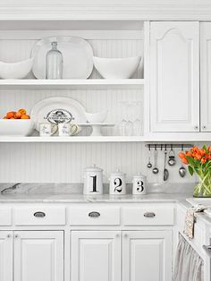 All-white in a kitchen makes everything seem upscale: http://www.bhg.com/kitchen/small/custom-touches-for-small-kitchens/?socsrc=bhgpin081114utensilsondisplay&page=3