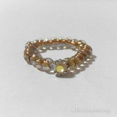 A dainty diamond ring fit for a princess. Gold Japanese seed beads with cubic zirconia diamond centre piece. Stretchable ring bend. Stack a few rings for extra bling!