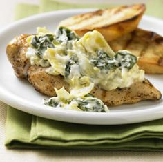 Grilled chicken breast topped with a creamy spinach-artichoke sauce similar to the dip