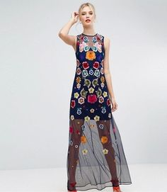 Pump up the drama with this maxi mesh dress decorated with bright embroidered florals.