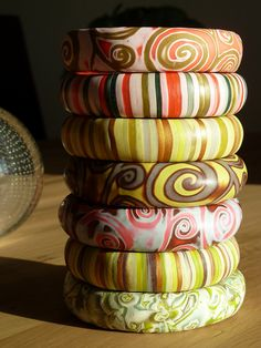 love the color choice!!! WHAT ARE YOU COVERING OVER W/ POLYMER CLAY?? A WOODEN BANGLE? ALUMINUM OR BRASS?