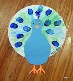 1 color art projects for preschoolers   coffee filter and blue and green colored…