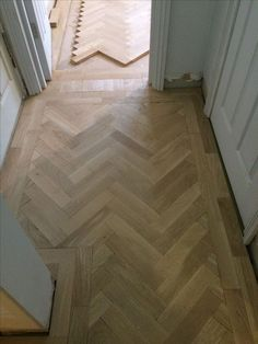 In progress of laying a prime grade oak parquet in a Herringbone pattern. In progress of laying a prime grade oak parquet in a Herringbone pattern. Flooring, Kitchen Flooring, Kardean Flooring, Wood Floor Design, Hall Flooring, Home, House Flooring, Herringbone Wood Floor, Herringbone Wood