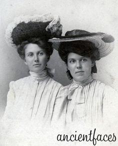 Susie Darling & Eathel Annamae Chase wearing fancy hats in 1894.