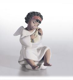 Lladro 06490 An Angels Tune http://lladro.stores.yahoo.net/04andream.html