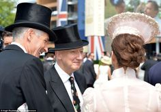 Admiring your work: Milliner Stephen Jones chats to a lady wearing a beautiful hat and an ...