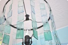 DIY Ombre Lamp out of Christmas Ornaments and Plexi-glass.