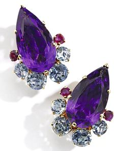 Pair of Gold, Amethyst, Aquamarine and Ruby 'Lotus' Earclips, Suzanne Belperron, France Set with two pear-shaped amethysts weighing approximately 15.00 carats, accented by round aquamarines and rubies, with French assay and maker's marks for Darde et Fils; 1955-1969.