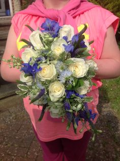 Fresh oval hand tied bouquet of white Norma Jean roses, blue Delphinium, blue Veronica , love in a mist by Michele knibbs of Muscari whites florist   www.muscariwhites.co.uk #muscariwhites
