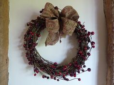 This is a very natural looking wreath. It is 12 inches in diameter and is covered with dark red berries. The wreath is finished off with a luxury ribbon which is printed with Merry Christmas in red and green. This wreath can go indoors or outdoors.  PLEASE NOTE IT SHOULD ONLY GO OUTDOORS IF IT IS IN A SHELTERED SPOT OUT OF THE RAIN.