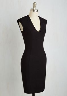 Every toast you propose in this black sheath dress is one to remember! With a plunging V-neckline and a sleek, textured silhouette, this figure-flattering number is ideal for every soiree and fete that fills your schedule. Your friends will raise a glass in your honor!