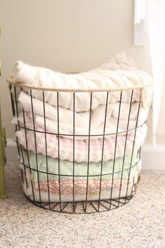 Project Nursery - WIRE BASKET FULL OF BABY BLANKETS, SITTING NEXT TO ROCKER