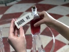 Go to the website for a gifset of different 'Drink Me' bottles in different Alice in Wonderland films Princess Aesthetic, Disney Aesthetic, Red Aesthetic, Alice In Wonderland Aesthetic, Adventures In Wonderland, Wonderland Alice, Wonderland Tattoo, Alice In Wonderland Photography, Princesa Alice