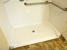 http://www.rvmaintenanceoptions.com/rvshowerpans.php has some information on shopping for a new shower pan for a RV.