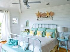Lovely seafoam & yellow bedroom with charming white plank walls via Coastal Living