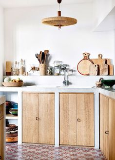woven pendant lamp and wood lower kitchen cabinet doors with tiled floors. / sfgirlbybay