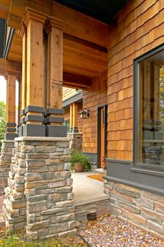 Shakertown cedar color with bronze dark accents and stone pillar combo. Perfect