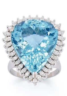 An Aquamarine and Diamond Ring Set with a pear-shaped aquamarine weighing approximately 40.00 carats, surrounded by marquise-cut diamonds, mounted in 18k white gold