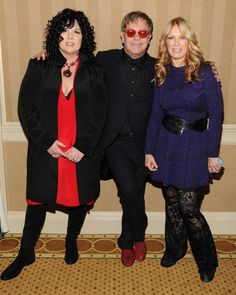 Three of a kind. Heart's Ann Wilson and Nancy Wilson mingle with Elton John at his 2013 AIDS Foundation benefit on Oct. 15 in New York