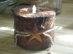TP Candle - spray paint a roll of tp - pinner used red, let dry,  paint on glue - do in sections and sprinkle coffee (dry used, or new) and cinnamon till covered, stuff middle with TP then put in battery candle, decorate as you like - let dry before adding ribbon or the like over night