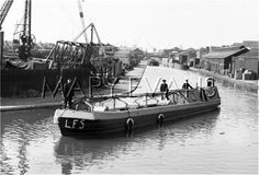 "Caption: ""A monkey barge fireboat fitted with trailer pumps"" #london #canal #fire #boat #narrowboat #wartime #war #barge #regents #ww2"