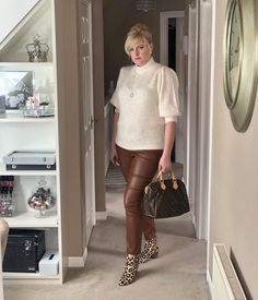 puff sleeve top and coated pants worn with booties | For more style inspiration visit 40plusstyle.com