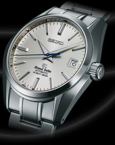 SBGH001 Hi-beat  Tradition and innovation combine in this model GRAND SEIKO. Its automatic movement features a high frequency escapement for better timekeeping stability with a specially designed escape wheel for better oil retention. It's beautifully finished, all-steel case and bracelet securely house an impeccable silver colored dial with blue second hand designed for exacting legibility. A real watchmaker's watch.