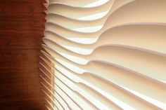 Custom wall assembly.  Back-lit CNC routed fin wall system by Provost Studio.