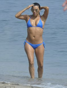87a93cd894 Blue belle: Eva Longoria showed off her toned figure in a tiny blue bikini  while