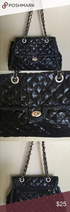 Big Buddah Jules Black Quilted Satchel/Crossbody Big Buddah Jules black quilted polyurethane w/ faux shearling trim has a silver chain dual satchel Crossbody length.. Rear pocket, 2 interior, 1 zip and a front twist tab closure over a zip closure.... Preowned in excellent condition Big Buddha Bags Satchels