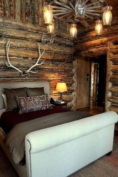 Rustic...can do without the antlers over the bed.