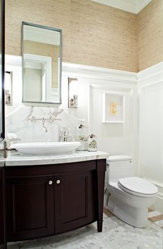 Elegant guest bathroom design with sand grasscloth wallpaper and white