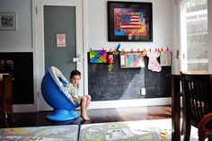 Love the chalk board paint and art hanging space.