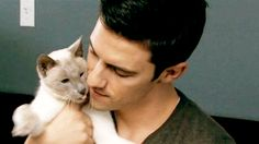MILO VENTIMIGLIA WITH A SIAMESE CAT. I think this picture just got me pregnant.