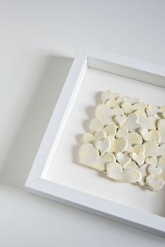 Hearts - 3D Sculpture from Ceramic, framed with a white square shape makes it more popping up