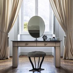 Penelope Toilette  Controluce: Italian #Home #Fashion   #Designed and #dressed by #CastelloLagravinese Studio.  The high tailoring details distinguish the series of Penelope units. The #Controlucehome #bedroom is completed by the #wonderful toilette #table covered in quilted leather featuring a timeless romantic look. The adjustable #mirror and the handles with a cameo lend to this piece of furniture an alluring #touch of #glamour.  #controlucehome