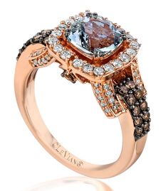Soothing Sea Blue Aquamarine sparkles from within Strawberry Gold sweetened with Chocolate Diamonds and Vanilla Diamonds.