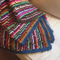 My daughter's scrap yarn blanket is finally done! Simple crochet project, perfect for all of those extra skeins of yarn sitting around (this took 16-20, but use what you have!) Groovy-ghan/Apache Tears. This is the link I used. http://www.acreativebeing.com/patterns/groovy-ghan-en/
