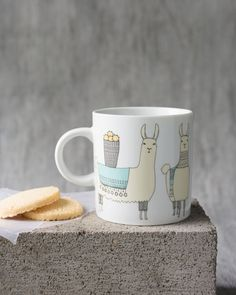 Llamarama Short Mug - This classic-shaped mug is a surefire conversation starter. Three lovely llamas bedecked in woven blankets and beaded necklaces trek through the Peruvian mountains with cargo atop their backs. Woven Blankets, Surefire, Beaded Necklaces, Llamas, Trek, Conversation, Kitchen Dining, Mugs, Mountains