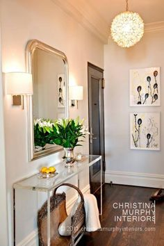 Maybe a Lucite table over a patterned cube for the entry.  Interior ideas from Christina Murphy Interiors
