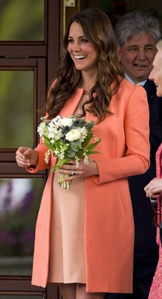 For a visit to Naomi House Children's Hospice, Kate wore a peach Tara Jarmon coat over a custom frock by an independent dressmaker. via StyleList