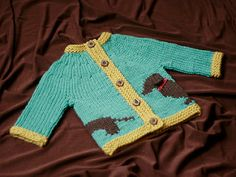 Willie is a round-yoked cardigan for babies and kids, with a lovable wiener dog that wraps around the lower body. The body and sleeves are knit separately, then joined in one piece for the yoke. If you don't love dogs, Willie also looks fetching in stripes and solids. Worked up quickly in chunky yarn, this cardigan makes a handy last-minute gift, and a fun introduction to intarsia knitting.