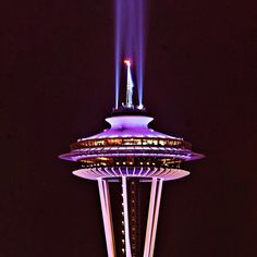 In honor of the passing of legendary UW football coach Don James, the Seattle space needle glowed in purple.