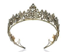 A George III diamond tiara from 1790. Designed as a series of foliate scrolls, set throughout with rose-cut diamonds to the closed-back setting, mounted in silver and gold.