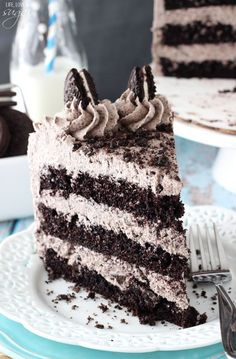 Chocolate Oreo Cake - Oh man, this looks delicious! Don't let the beautifully decorated outside fool you - it really isn't too hard to make!