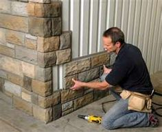 Faux stone. Easy to pop on the side of a house for an exterior change. Like an ugly garage........