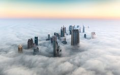 Dubai Emerging from the Fog | Not all of us have taken in the gorgeous scene that is Dubai from above. We can help: Ahead, stunning shots of the most populous city in the United Arab Emirates.