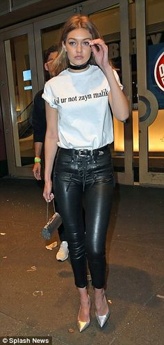 Supporting her man:The leggy blonde was seen in Times Square, New York sporting a white T-shirt, which read: 'lol ur not zayn malik'