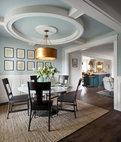 The ceiling treatment in here added a great deal of architectural detail to the dining room. It gives this space a grand, traditional feel while creating a distinct focal point. The detail makes the room feel larger and draws your eye right up to it. We painted the room and the ceiling a light shade of blue, to make the trimwork and white wainscoting look even more dramatic.
